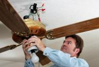 a Sunnyvale electrician is installing a ceiling fan